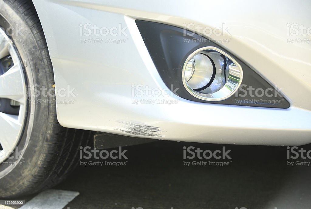 scratched front bumper of vehicle's paint skin stock photo