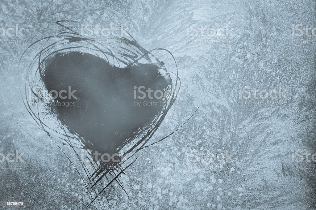 scratched heart on frosty window stock photo