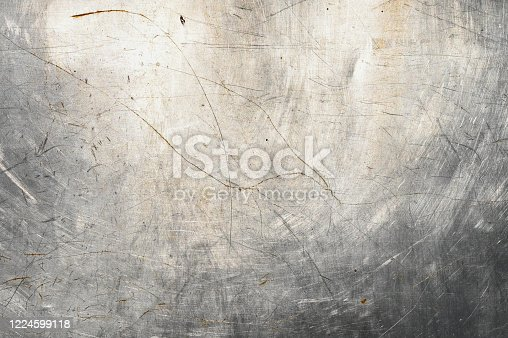938345942 istock photo scratched metal background. poured paint. metal texture can be used as background 1224599118