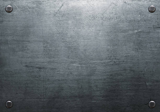 Scratched metal plate Dark metal background with rivets metal stock pictures, royalty-free photos & images