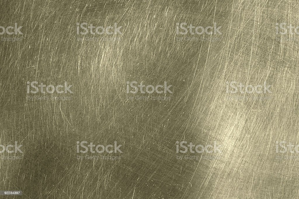 Scratched metal texture slightly golden color royalty-free stock photo