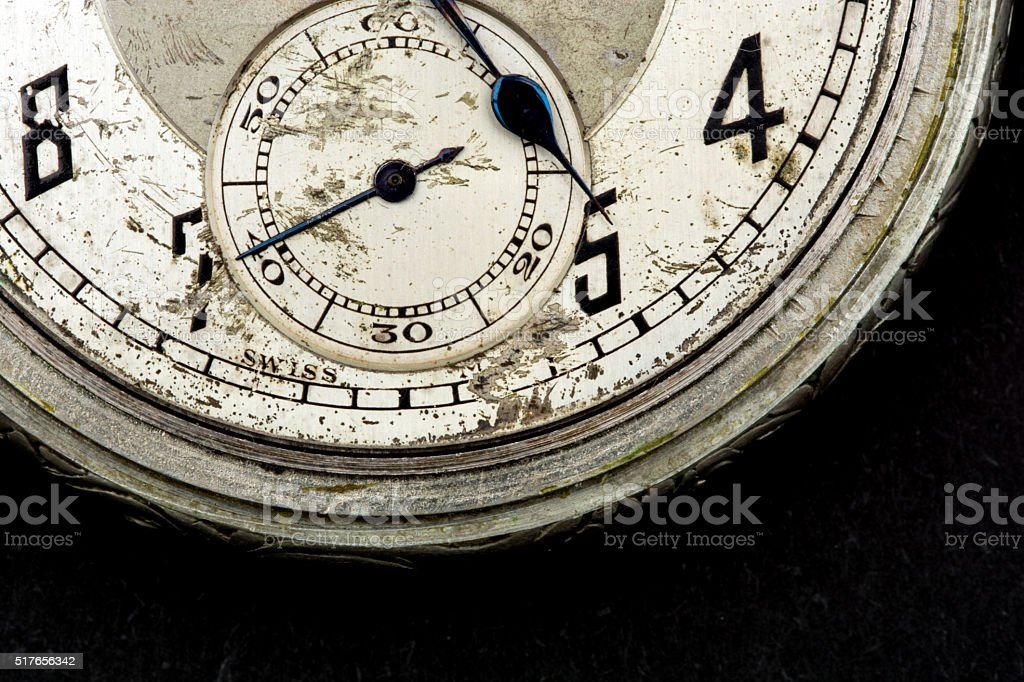 Scratched old pocket watch face 40 seconds stock photo