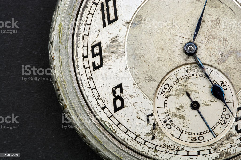 Scratched old pocket watch face numbers 7 to 10 stock photo