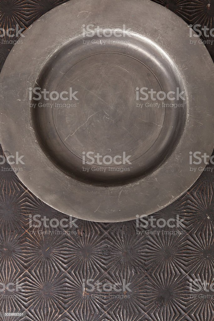 Scratched Pewter Plate And A Vintage Baking Tray stock photo