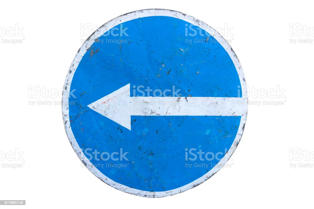 Scratched round blue road sign 'Turn Left' isolated on white. stock photo
