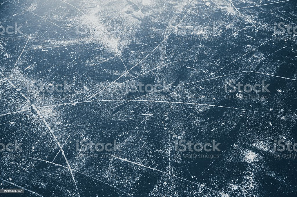 Scratched surface of a lake ice rink stock photo