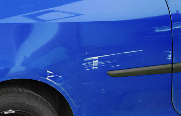 Scratches and dents on a blue car. Accidental damage to a car Scratches and dents on a blue car. Accidental damage to a car lacquered stock pictures, royalty-free photos & images