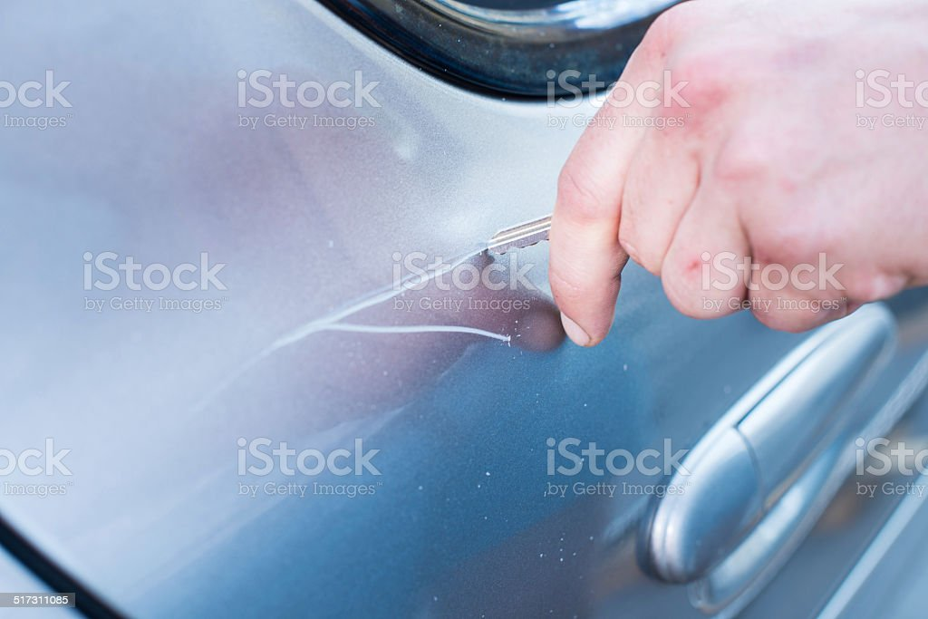 Scratching Car With A Key stock photo