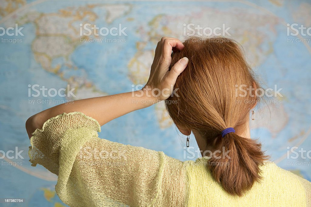 Scratching Her Head royalty-free stock photo
