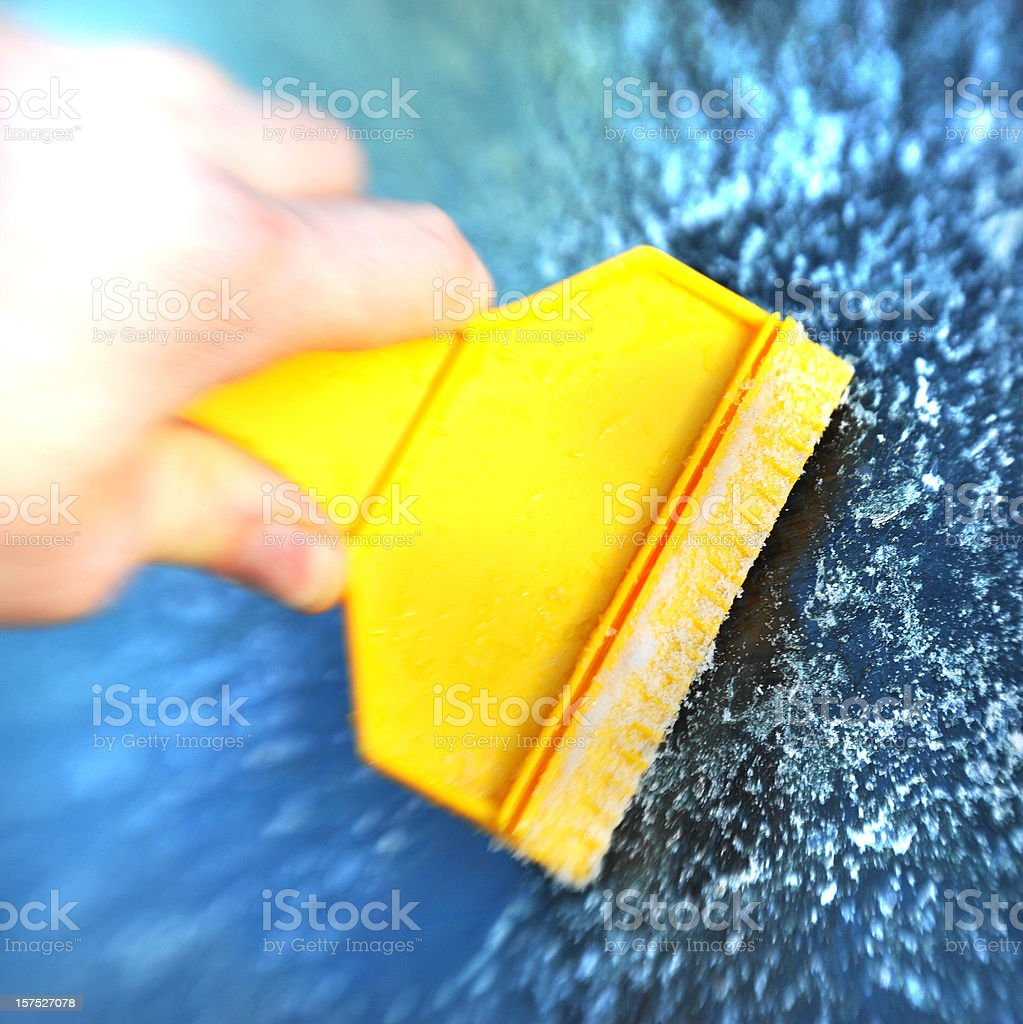 scratching ice with yellow utensil royalty-free stock photo