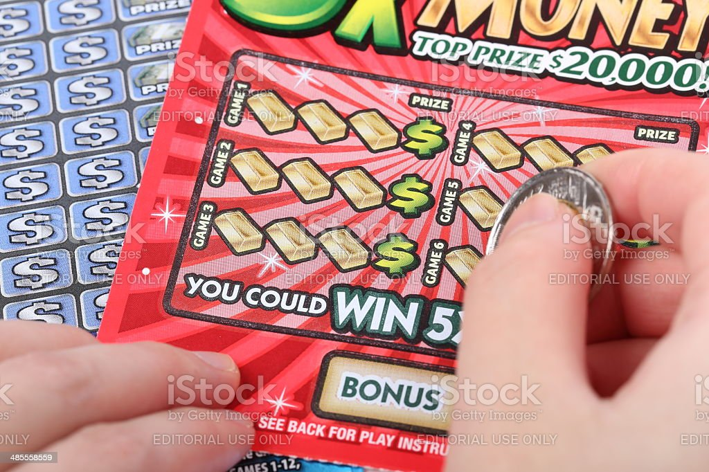 Scratching lottery ticket. stock photo
