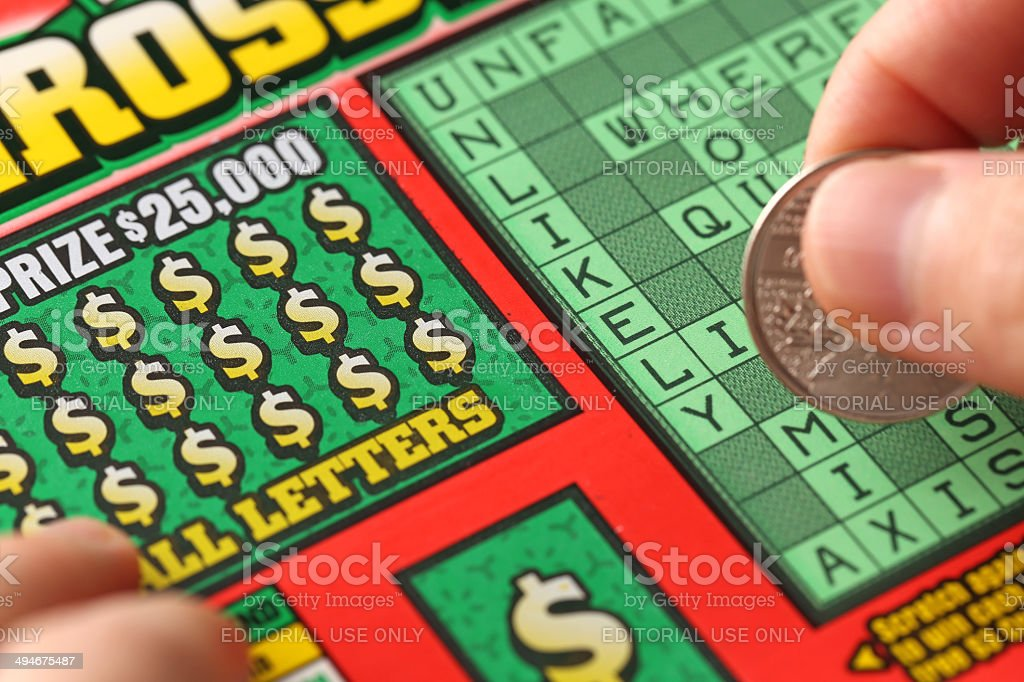Scratching lottery ticket stock photo