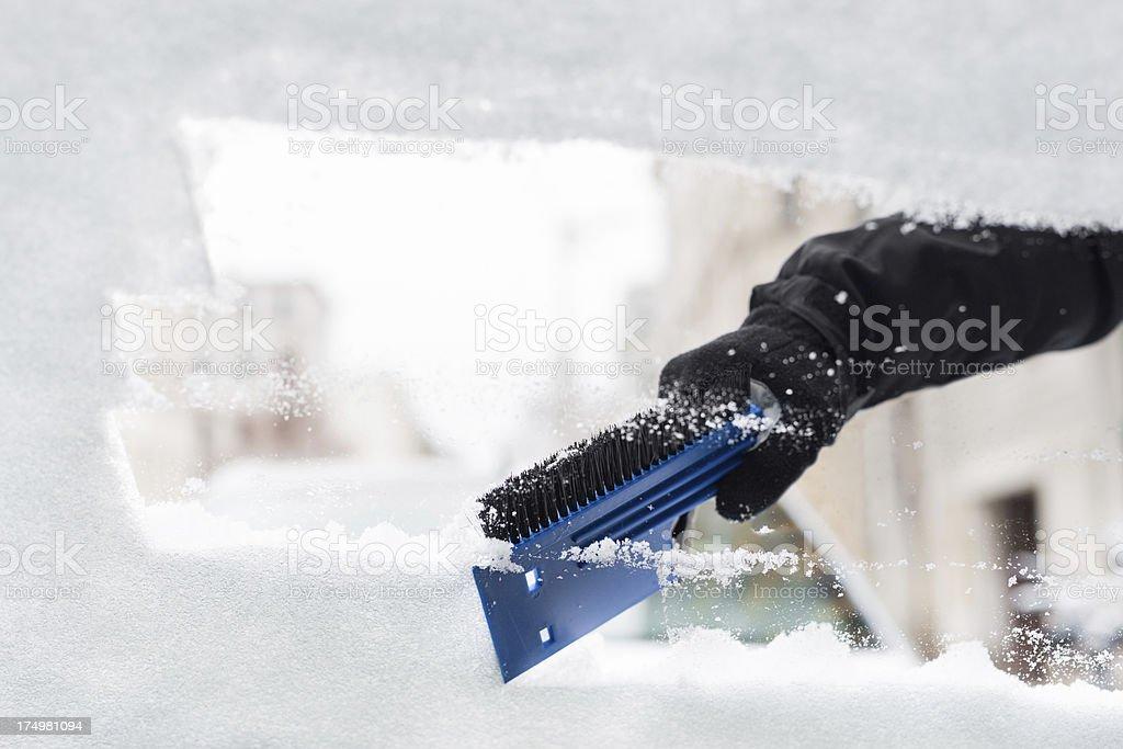 Scratching Snow on Car Window stock photo