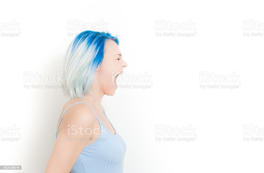 Scream of young hipster teen woman stock photo