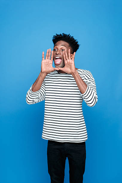 screaming afro american young man - single word stock photos and pictures