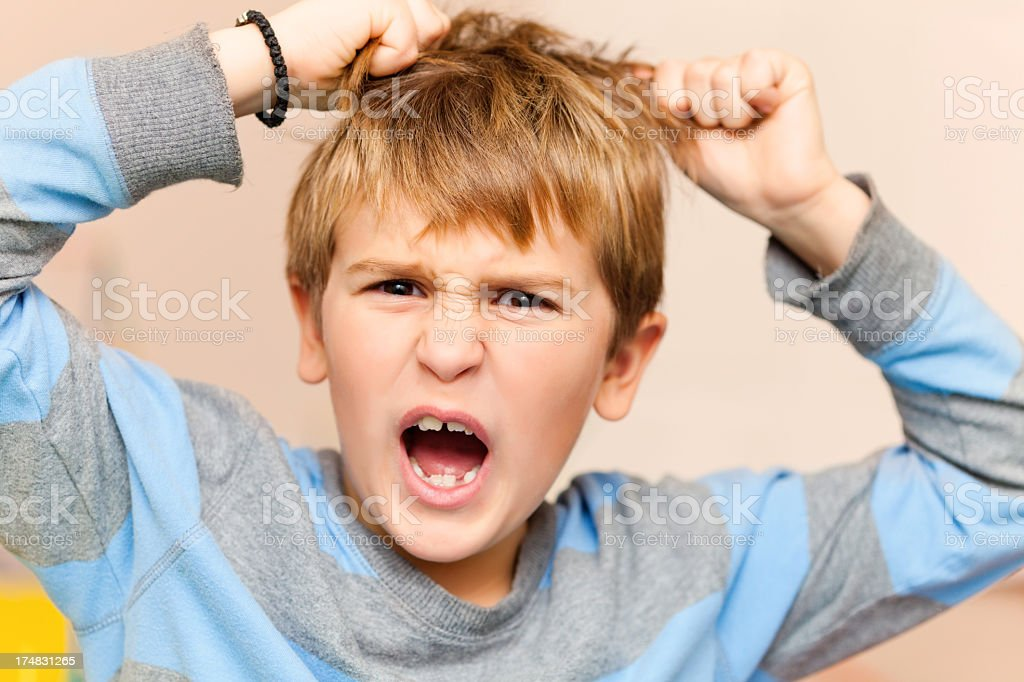 Screaming angry little boy royalty-free stock photo