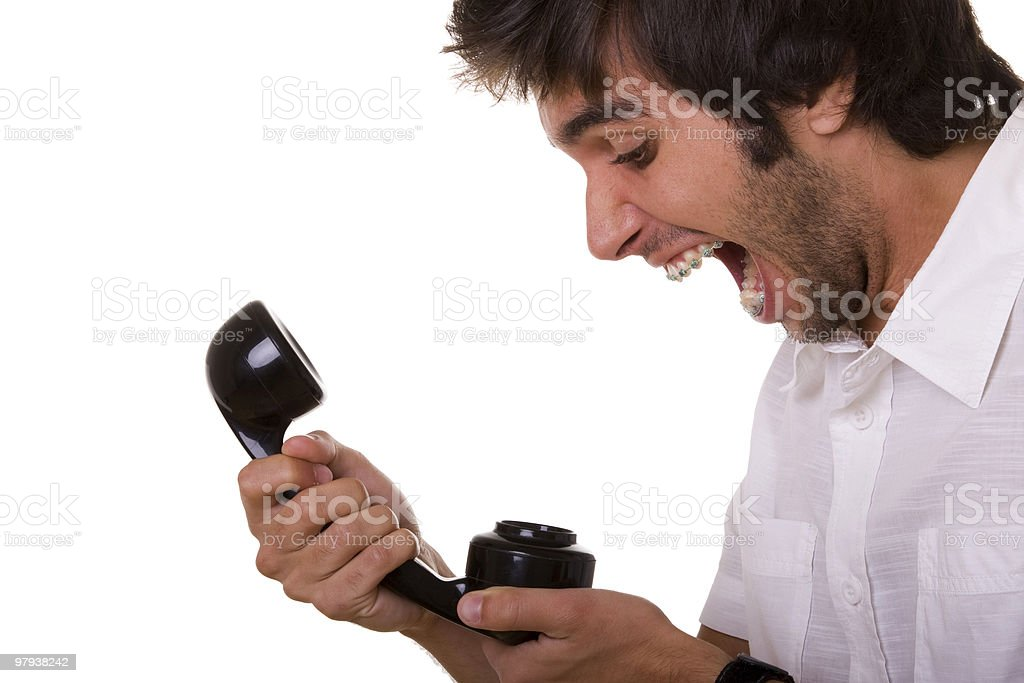Screaming at the telephone royalty-free stock photo