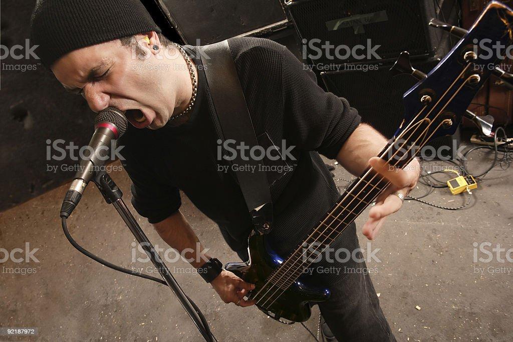 Screaming bass player stock photo