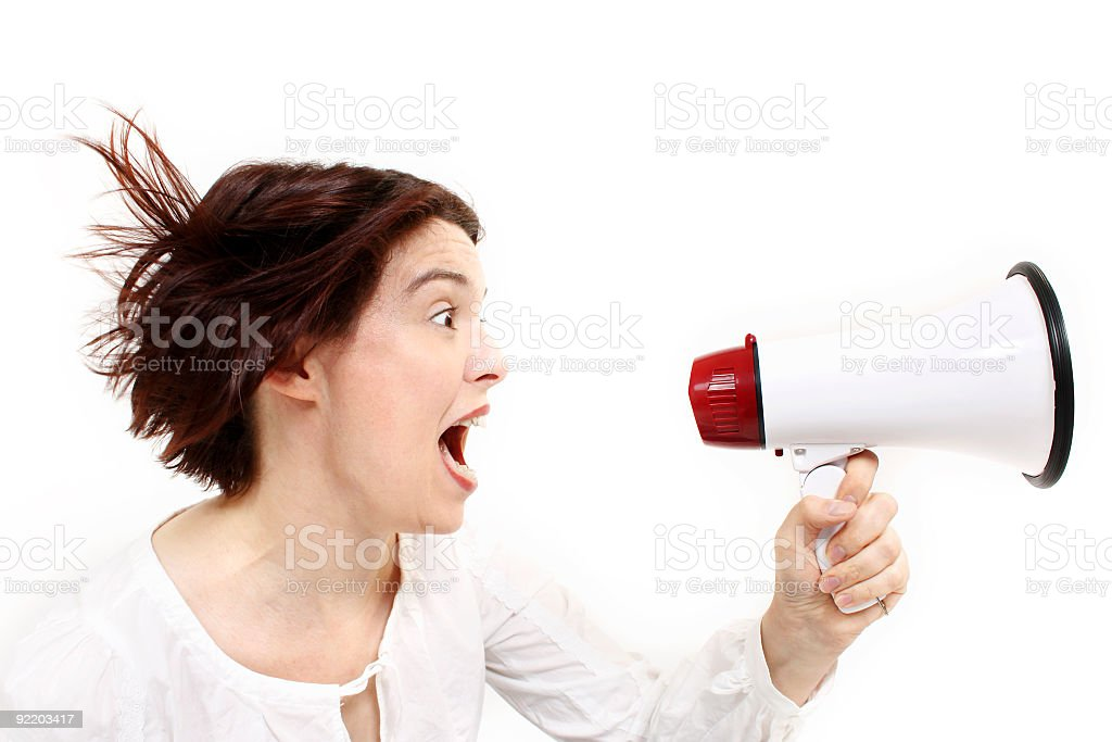 Screaming businesswoman with megaphone royalty-free stock photo
