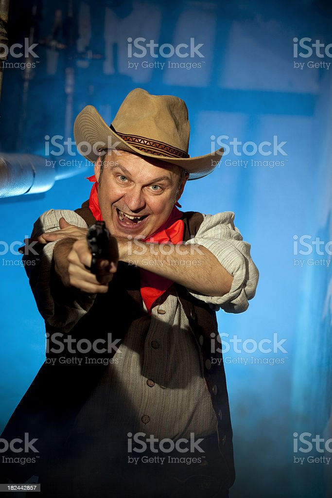 Screaming cowboy with gun in foggy bunker royalty-free stock photo