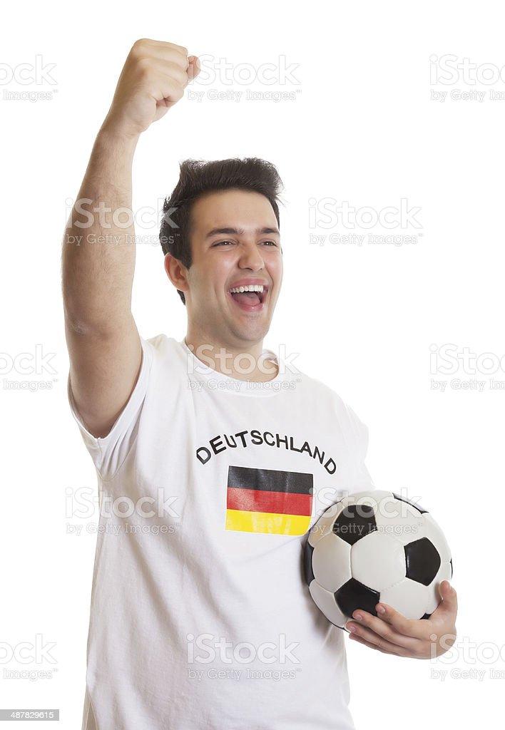 Gritando fã de futebol, com bola de futebol alemão - foto de acervo