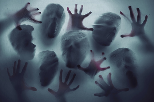 istock Screaming ghost faces 1051146310