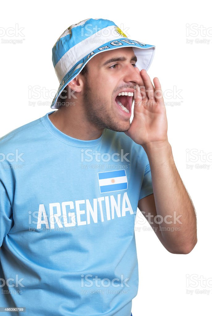 Screaming guy with argentinian jersey and hat stock photo