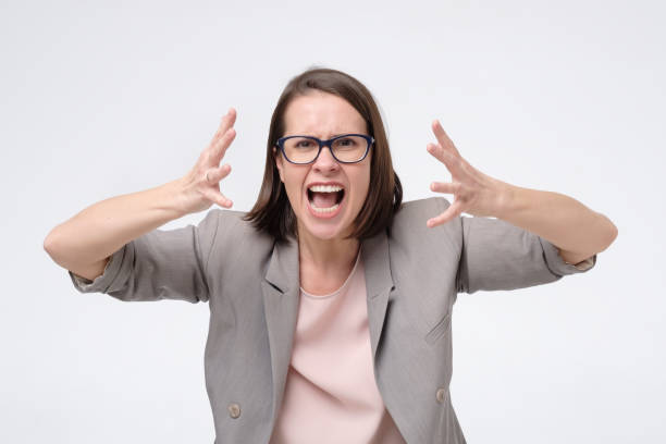 Screaming, hate, rage. Crying emotional angry woman screaming on white studio background. stock photo