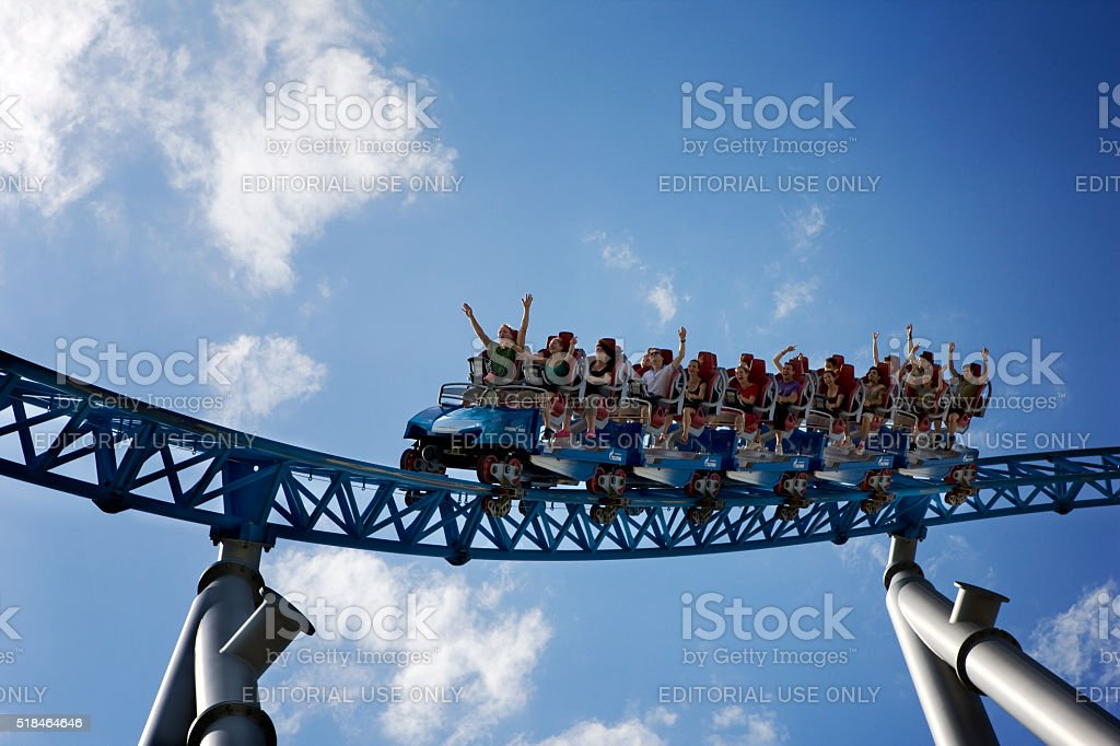 screaming people of all ages riding roller coaster stock photo