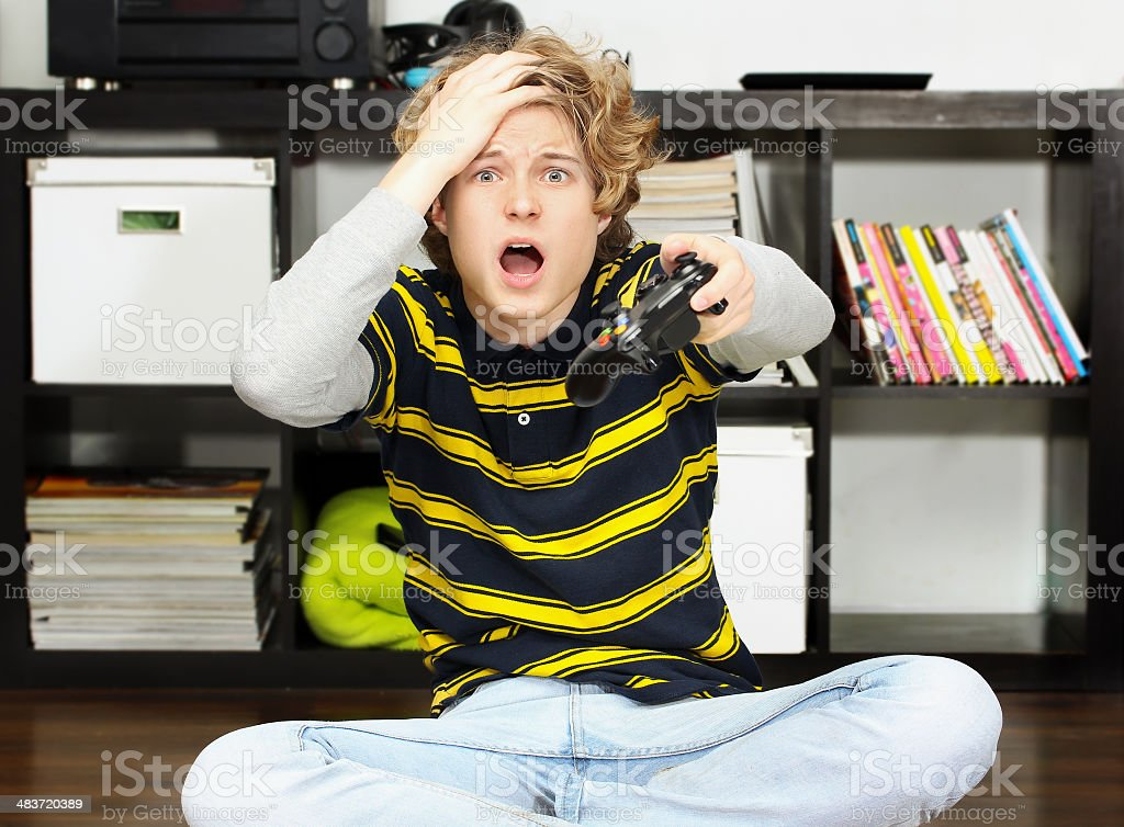 Screaming teenage boy  playing  game royalty-free stock photo
