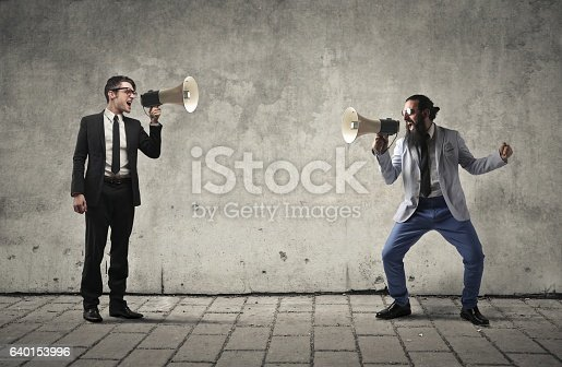 istock Screaming with each other 640153996