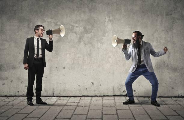 screaming with each other - debate стоковые фото и изображения