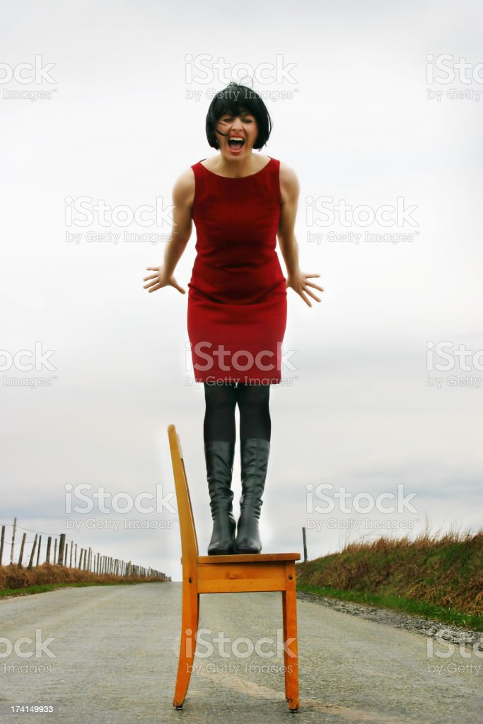 Screaming woman on a chair stock photo  sc 1 st  iStock & Royalty Free Standing Up From Chair Pictures Images and Stock ...