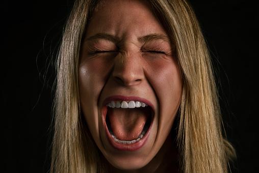 487960859 istock photo Screaming Woman 1014225176