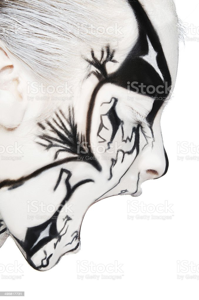 Screaming Woman With Black And White Paint On Face Stock Photo