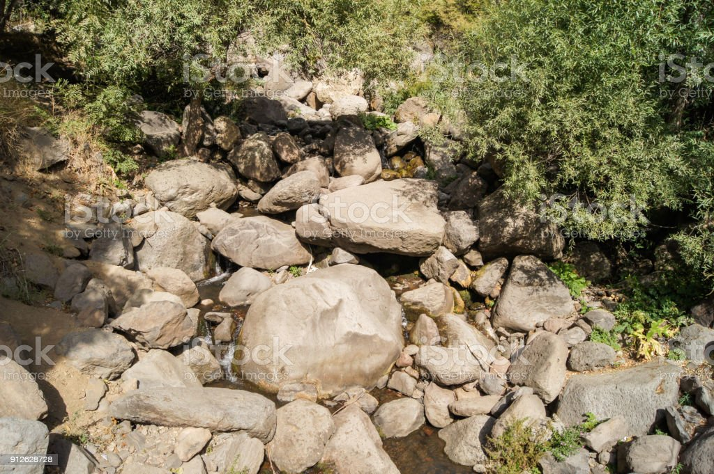 A scree of rocks in the water. stock photo