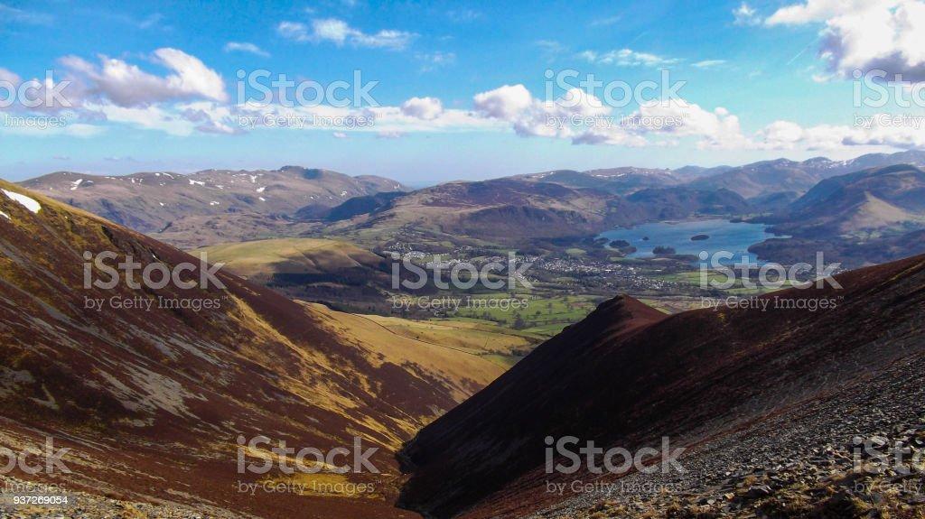 Scree valley to lake stock photo