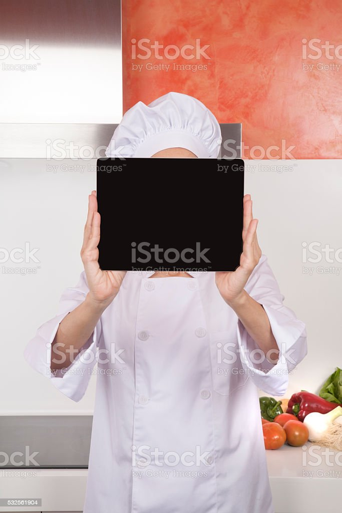 screen blank tablet over chef face stock photo