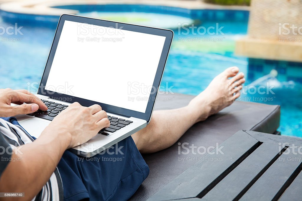 Screen mockup of laptop man using in pool on vacation stock photo