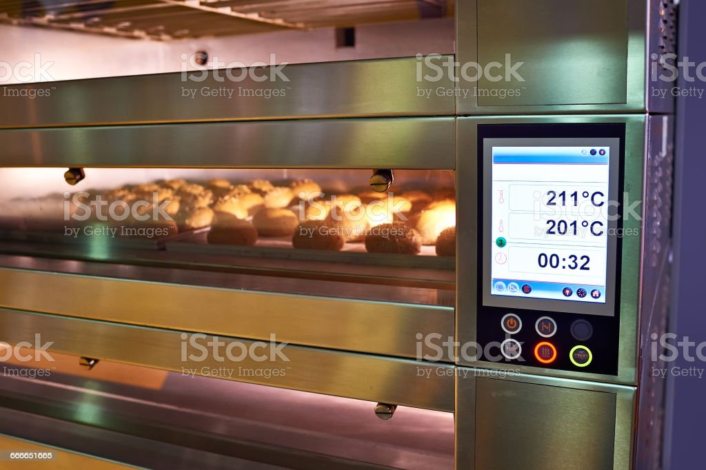 LCD screen of oven with bread in bakery stock photo