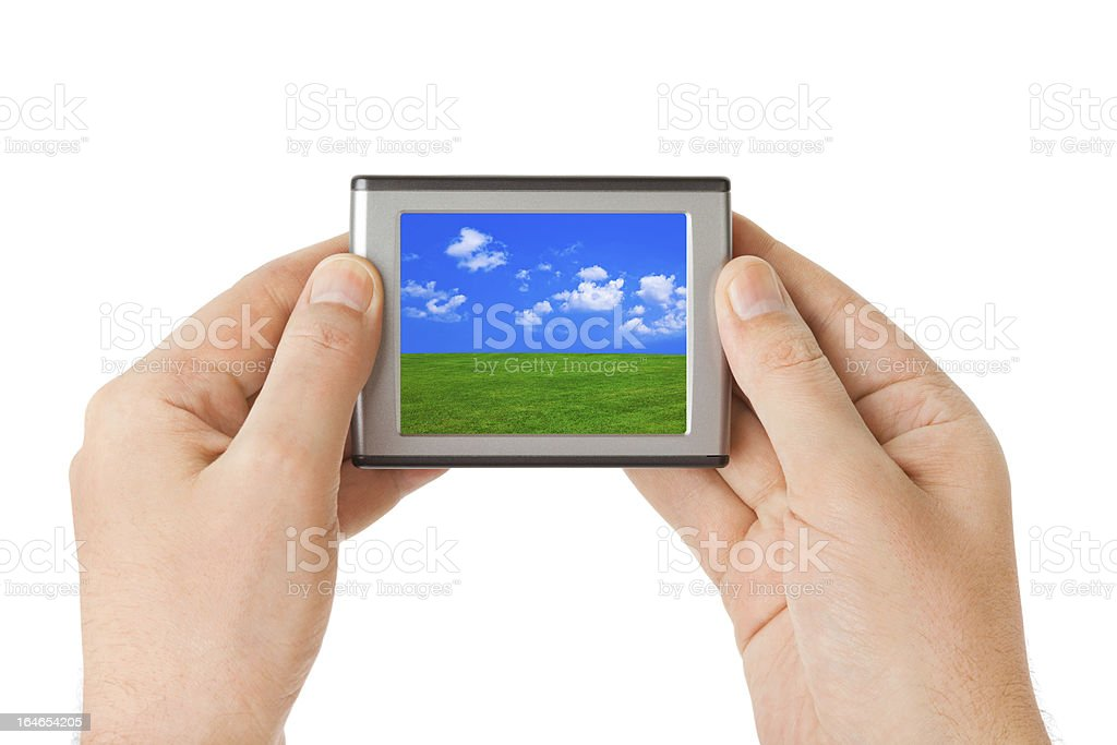 Screen with landscape in hands royalty-free stock photo