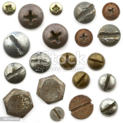 Various heads of screws and bolts on a white background.