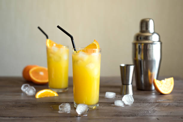 Screwdriver Cocktail, vodka and orange juice Screwdriver Cocktail with vodka, ice and orange juice. Homemade screwdriver cocktail drink on wooden table, copy space. screwdriver drink stock pictures, royalty-free photos & images