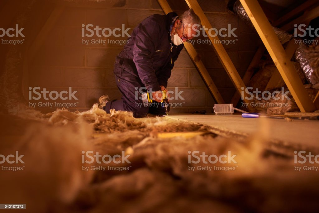 screwing down floorboard stock photo