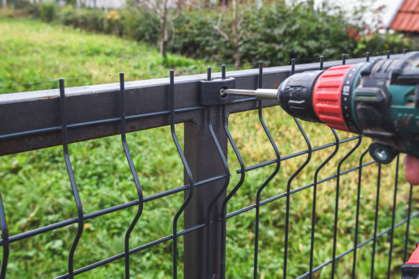 Screwing grating fence stock photo