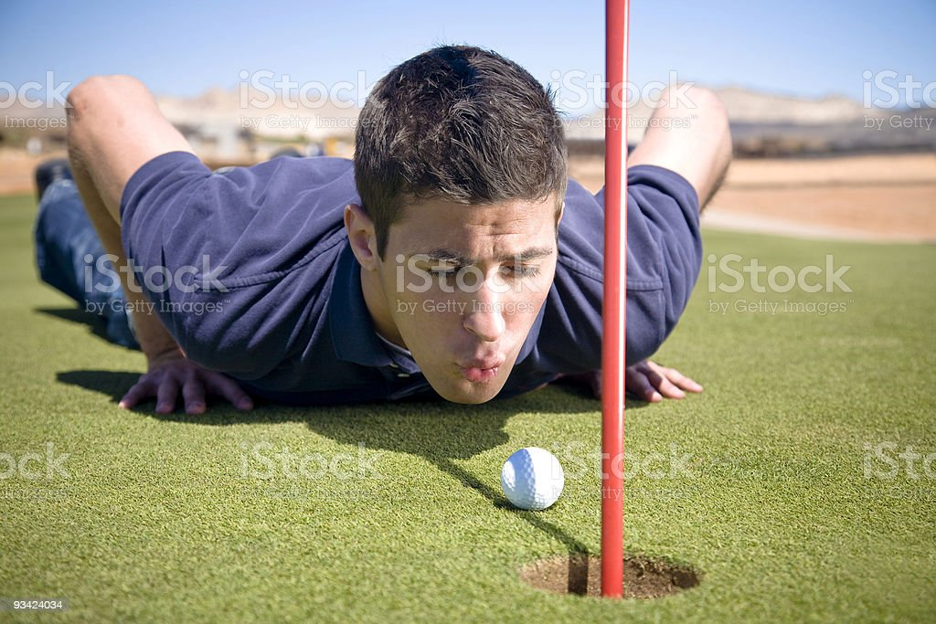 screwing the golf rules stock photo