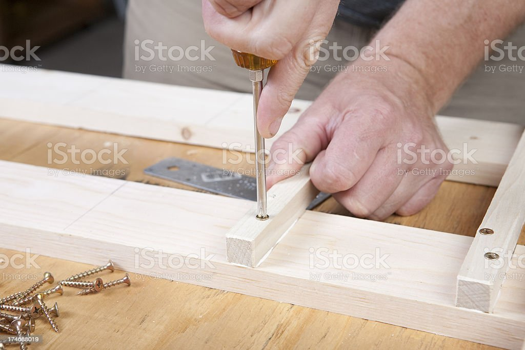 Screws into the wood royalty-free stock photo