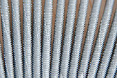 Screws for sandwich panels. Metal screws are used to fasten insulation panels to the metal frame of a new building.