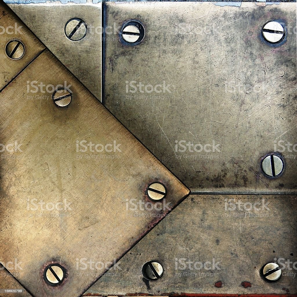 screws on brass metal texture ; abstract background royalty-free stock photo