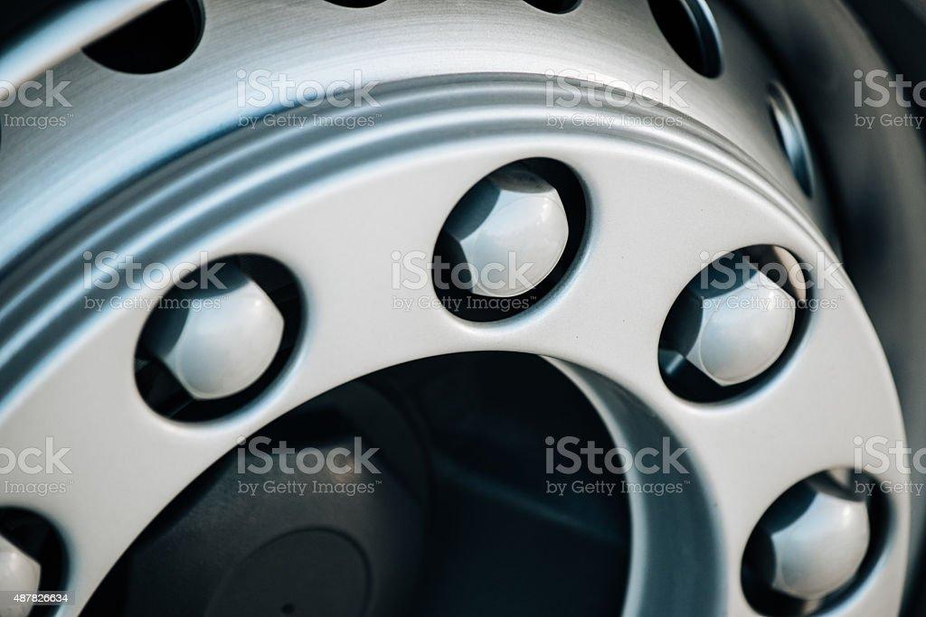 Screws on truck's alloy wheel stock photo